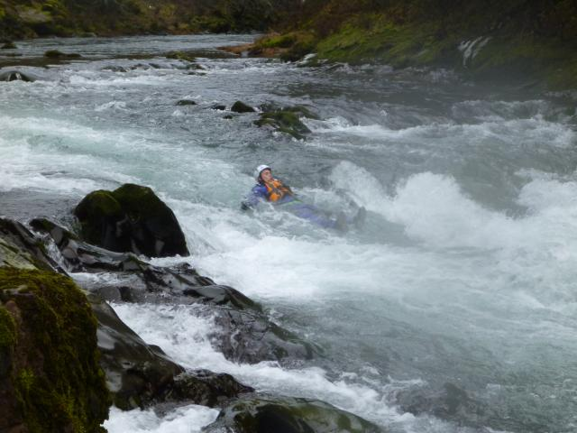 Swimming down rapids to practive swift water rescue swimming